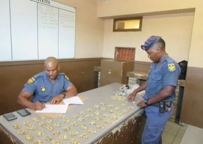 Sgt Mahlomola Mbele and Sgt Mpho Monoto with drugs.